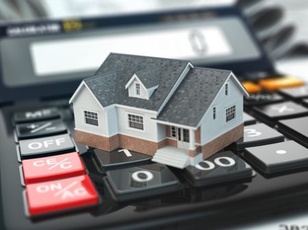 52894902 - mortgage calculator. house on buttons. real estate concept. 3d
